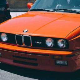 Cover of track i want an orange bmw so i can drive far away from here by metrom